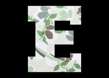 Letter E – with flowery fabric texture on black background 写真素材