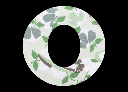 Letter O – with flowery fabric texture on black background