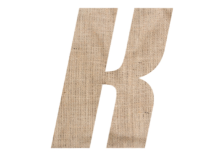 Letter K with burlap texture on white background