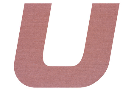 Letter U with terracotta colored fabric texture on white background 写真素材
