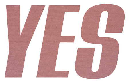 YES word with terracotta colored fabric texture on white background