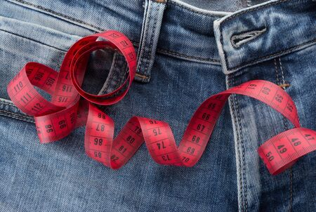 jeans with red measuring tape.