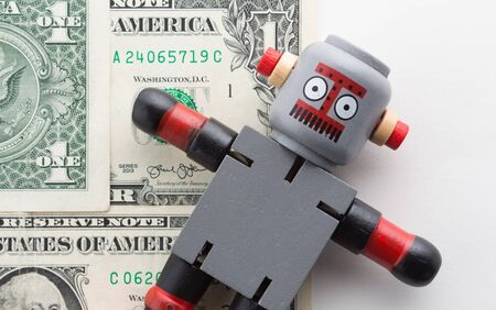 Wooden Robot with One Dollar Paper Currency.