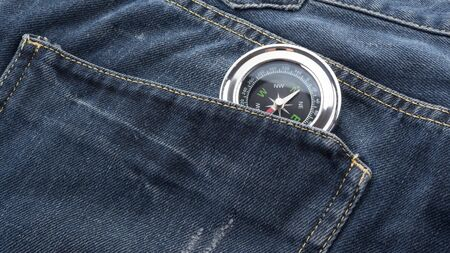 compass in jeans back pocket
