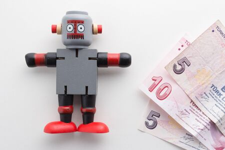 Wooden Robot with Turkish Paper Currency.