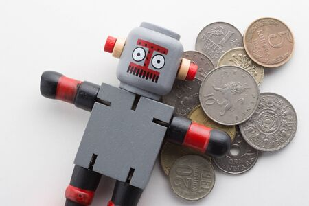 Wooden Robot with Old Coins.