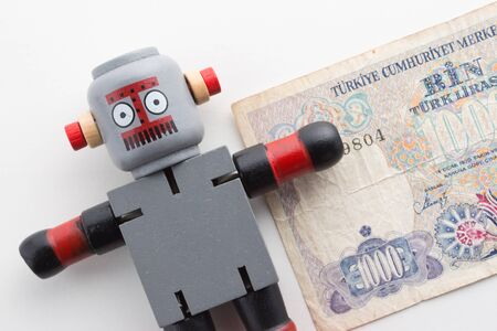 Wooden Robot with Old Turkish Money.
