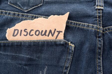 DISCOUNT note in jeans pocket. Stock fotó