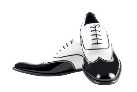 gangster background: black and white leather mafia shoes