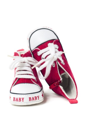 Pair of red and white baby shoes on white background Stock fotó