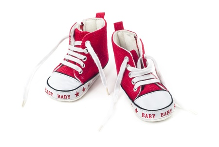 13220981 , 白地に赤と白の赤ちゃんの靴のペア