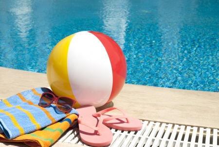Summer vacation accessories  by the swimming pool photo