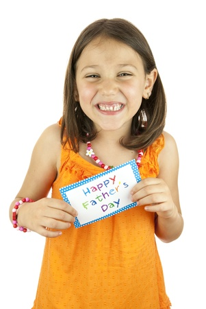 girl holding a fathers day card in her hand