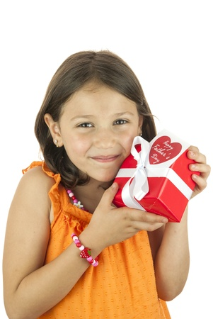 girl holding a gift box in her hand