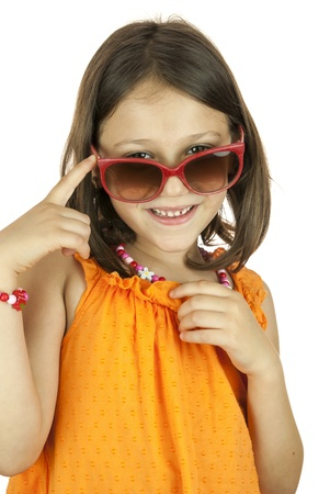 Little girl smiling and wearing red sunglasses photo