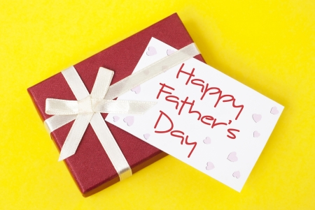 father's day: gift box and fathers day card on yellow background