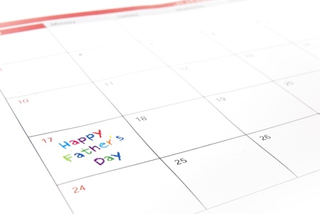 Colorful fathers day note on white calendar photo