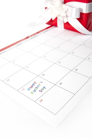 gift box and calendar showing fathers day photo