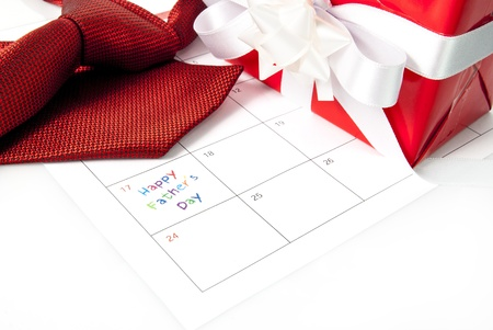 Red tie, gift box and calendar showing fathers day Stock Photo - 13942431