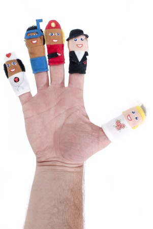 Various finger puppets showing different jobs on white background photo
