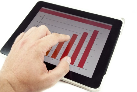 Human hand showing diagram on tablet computer photo