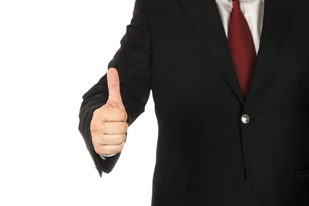 Businessman showing his thumb up on white background  photo