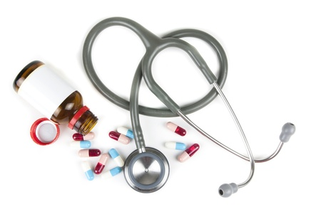 longevity drugs: silver and blue stethoscope and colorful pills on white background
