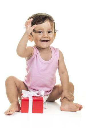 red gift box: pretty baby with red gift box on white background