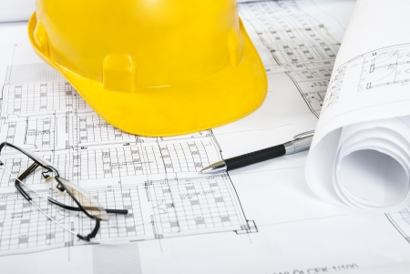 House Blueprints, yellow helmet, pen and glasses