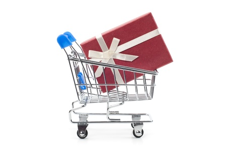 red gift box in steel shopping cart photo