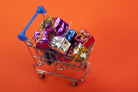 colorful gift boxes in steel shopping cart photo
