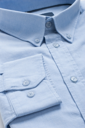 New folded blue men shirt, close-up macro