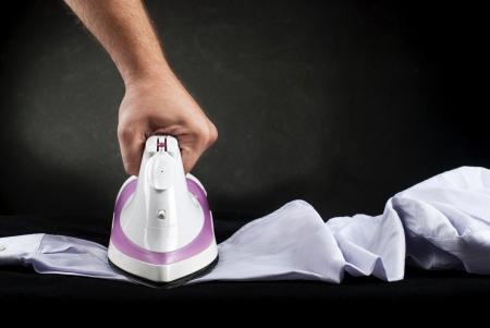 Hand ironing shirt with Hot steam iron