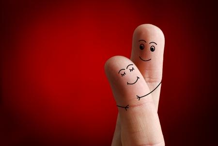 Een gelukkig paar in liefde met geschilderde smiley, Valentijnsdag Stockfoto
