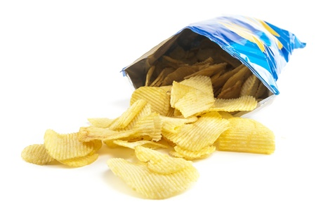 potato chip: heap of potato crisps on white background Stock Photo