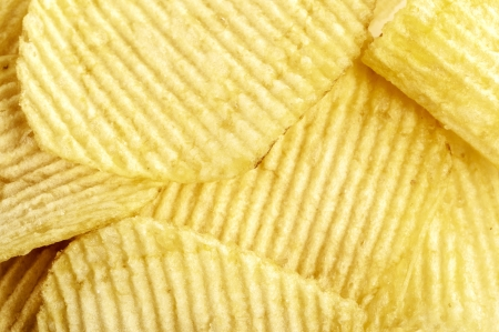 closeup photo of crispy yellow potato crisps