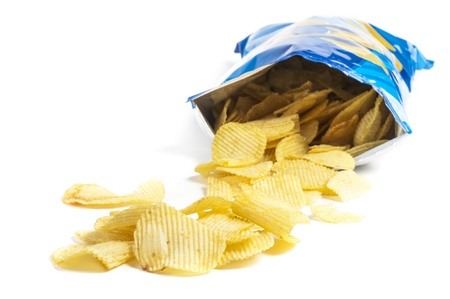 crisps: heap of potato crisps on white background Stock Photo