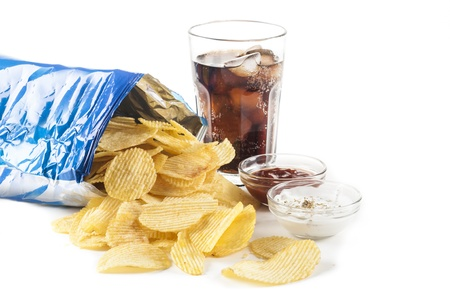 glass of coke potato crisps and ketchup and mayonnaise Stock Photo