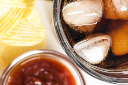 carbonation: glass of cold coke with ice cubes