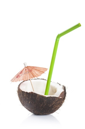 coconut cocktail with green drinking straw and cocktail umbrella on white background photo