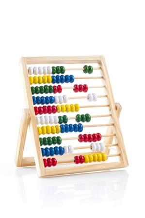 Traditional abacus with colorful wooden beads on white background photo