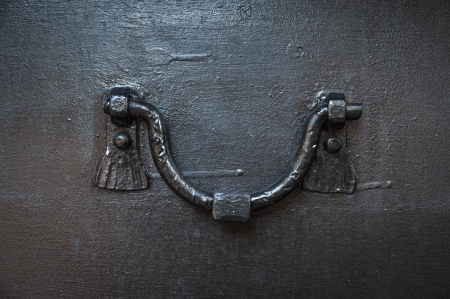 close-up of ancient doorknob of iron door photo