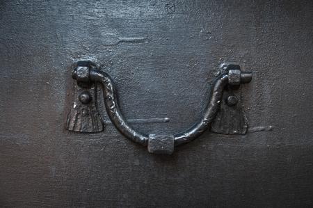 doorknocker: close-up of ancient doorknob of iron door