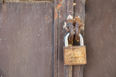 close-up photo Old rusty padlock on a iron door photo