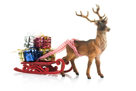 Red Sledge with Christmas gift boxes and reindeer on white background