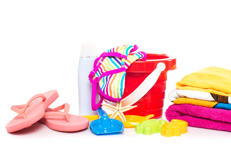childrens beach toys isolated on white background photo