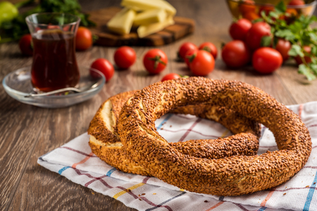 Traditional Turkish bagel with tea, cheese and tomato