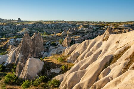 Magical fairy chimneys in the canyon near in Goreme, Cappadocia, Nevsehir Province in the Central Anatolia Region of Turkey