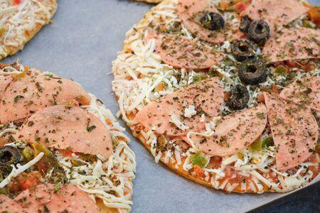 Frozen Italian pizza ready to be baked