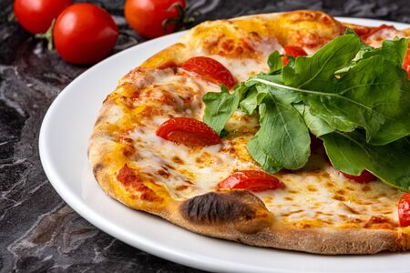 Delicious hot homemade pizza on the stone table background